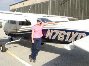 Joni M Fisher with plane