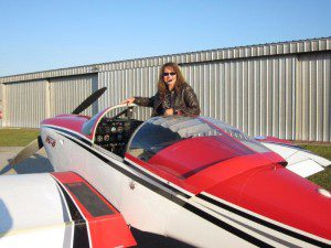 Joni climbing into an RV-6